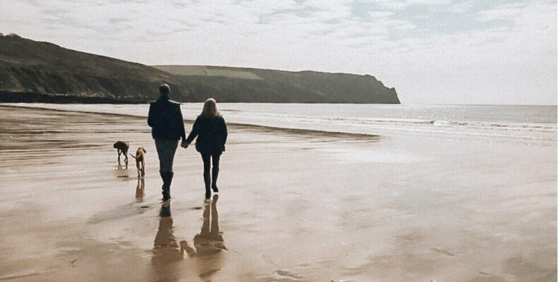 ESFJ ISFJ Relationships: Claire and Andy walking on the beach holding hands