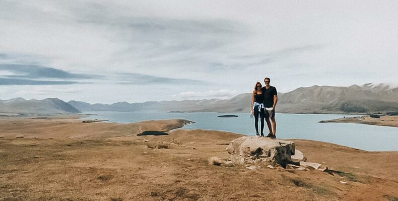 ESTP ISFJ Relationship: Maia and Tom on a rock in New Zealand