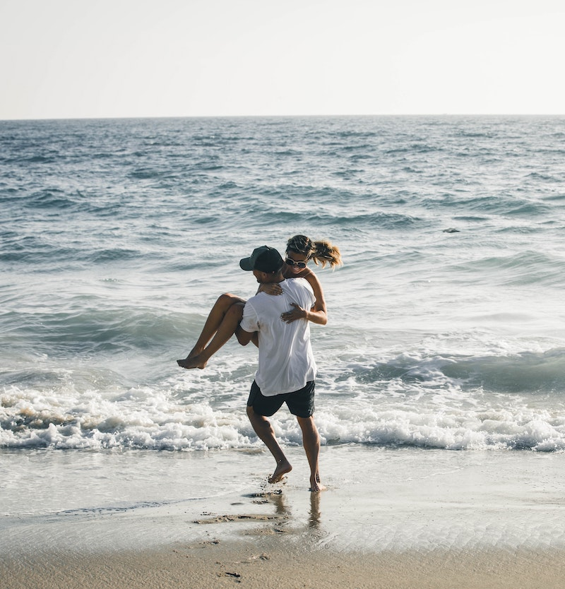 Myers Briggs match: couple laughing on the beach